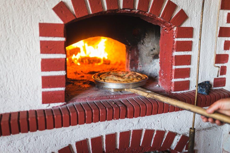 Kapilio taverne met vleespastei, Griekenland